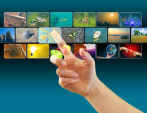 Hand browsing images in touch screen virtual space Royalty Free Stock Photo