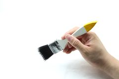 Hand with brush Royalty Free Stock Images