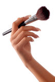 Hand with brush. Close-up hand with make-up brush on the white background Royalty Free Stock Image