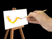 Hand with brush, abstract drawing. Isolated Royalty Free Stock Photography