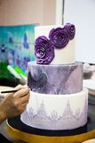 Decorating wedding cake colouring by brush royalty free stock images