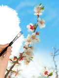 The hand with a brush draws a landscape Royalty Free Stock Images