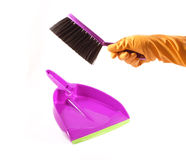 Hand with brush and dustpan Royalty Free Stock Photography