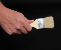 Hand and Brush Stock Photo