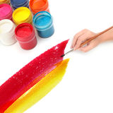 Hand with brush and paint Royalty Free Stock Images