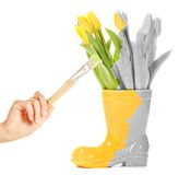 Hand with brush painting vase Stock Images