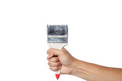 The hand with a brush paints in white background Royalty Free Stock Photos