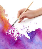 Hand with brush and watercolor. Paint royalty free stock photos