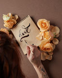 Hand with brush writing a love letter Royalty Free Stock Photos