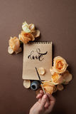 Hand with brush writing a love letter Royalty Free Stock Photo
