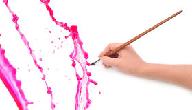 Hand with brushand paint splash. Hand with brush and paint splash royalty free stock photography