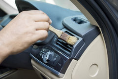 Hand brushing the car dashboard Royalty Free Stock Photo