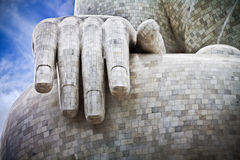 Hand of Buddha. The hand of a massive Buddha sculpture decorated with pieces of marble, Phuket, Thailand Royalty Free Stock Photo