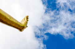 Hand of Buddha statue on blue sky.  Royalty Free Stock Photos