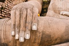 Hand of Buddha statue on left Royalty Free Stock Photo