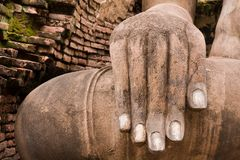 Hand of Buddha statue on right Royalty Free Stock Images