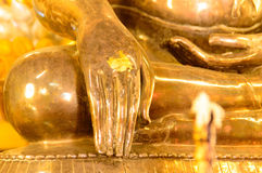 Hand of Buddha statue. In Thai Buddhist Temple Stock Photos