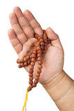 Hand with Buddhist rosary Stock Image