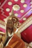 Hand of buddhist statue. Focus of buddhist statue's hand Royalty Free Stock Photos