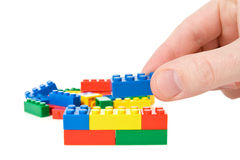 Hand build a color plastic  bricks Stock Image