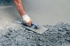Free Hand Builder With Trowel Leveling Concrete 2 Stock Photography - 103873192