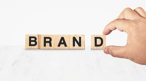 Hand building brand on white Stock Image