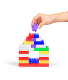 Hand building a house of blocks Royalty Free Stock Image