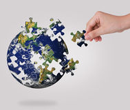 Hand Building Puzzle Globe. Royalty Free Stock Images