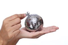 Free Hand Building Puzzle Globe Royalty Free Stock Image - 34699946