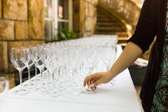Hand building a several wineglasses Royalty Free Stock Photo