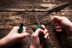 Hand with building tools on Labor Day Stock Image
