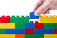 Hand building up a block Royalty Free Stock Image
