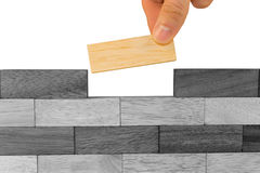 A hand building wall Stock Images