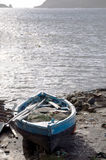 Hand built native fishing boat on shore bequia Royalty Free Stock Photo