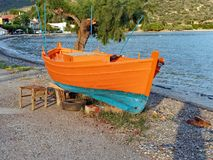 Small Wooden Greek Fishing Boat, Annual Repainting, Greece Stock Photos