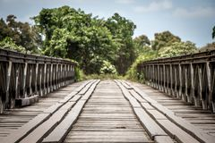 A hand built wooden bridge in Papau New Guinea stock photography