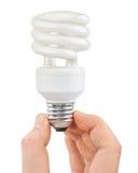 Hand with bulb Stock Photos