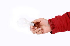 Hand-bulb. A man's hand holding a light bulb against a white background Royalty Free Stock Photo