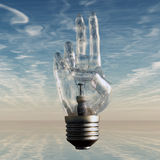 Hand bulb and sky Stock Photography