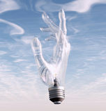 Hand bulb and sky Royalty Free Stock Image