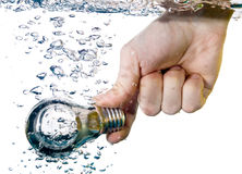 Hand and bulb in water Royalty Free Stock Image