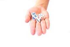 A hand with a bunch of dice Stock Photography