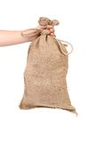 Hand with burlap sack Stock Photos