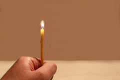 Hand with a burning candle Royalty Free Stock Photography