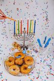 Hand burning candles Menorah on wooden background. Jewish holiday, Holiday symbol Hand burning candles on Menorah on wooden background Royalty Free Stock Photo