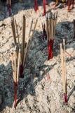 Hand burning incense Stock Photos