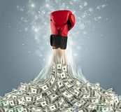 Hand bursting out from a money heap. Hand bursting out from a huge money pile stock image