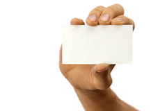 Hand and business card. The hand of man shows a business card. Isolated on white royalty free stock photos