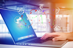 Hand business icon going out a computer interface of a man at th. View of Hand business icon going out a computer interface of a man at the office - Business Stock Images