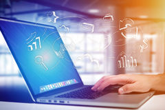 Hand business icon going out a computer interface of a man at th. View of Hand business icon going out a computer interface of a man at the office - Business Royalty Free Stock Image